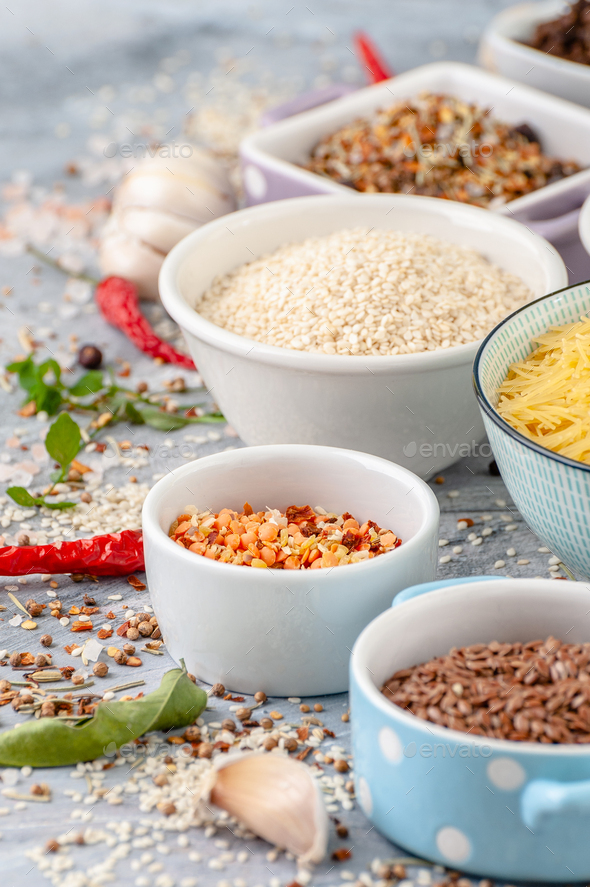 Various oriental spices and seasonings on an old scratched table - Stock Photo - Images
