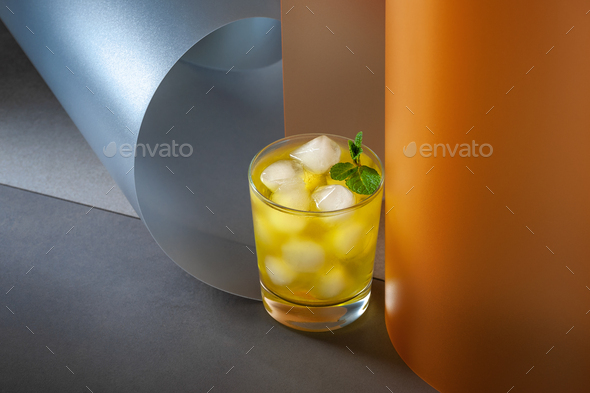 Ice cold drink on creative color background. - Stock Photo - Images