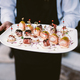 Waiter holding plate with canapés - PhotoDune Item for Sale