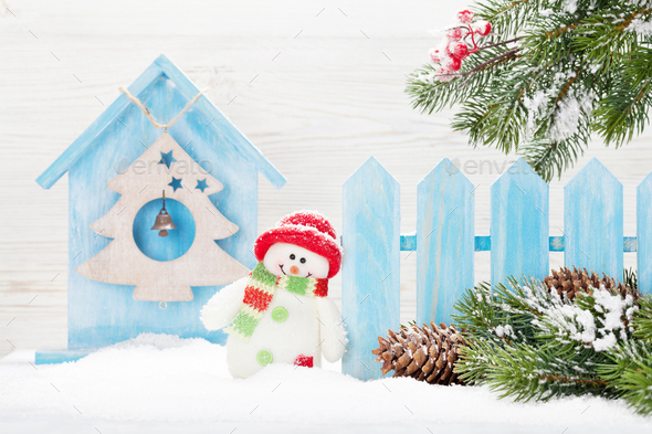 Christmas snowman and fir tree - Stock Photo - Images
