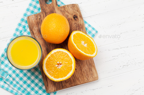 Fresh orange juice and oranges - Stock Photo - Images