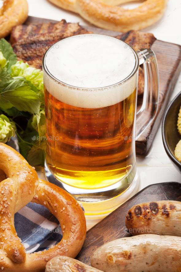 Oktoberfest set. Pretzels, sausages and lager beer - Stock Photo - Images