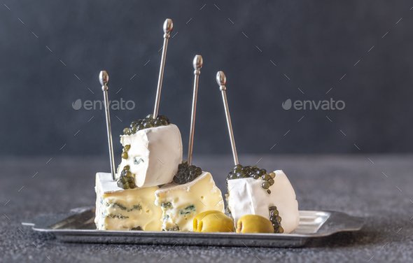 White and blue mold cheese with black caviar - Stock Photo - Images