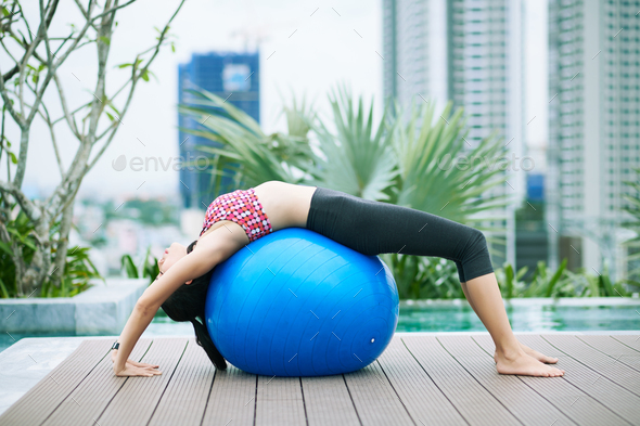 Woman exercising with fitness ball - Stock Photo - Images