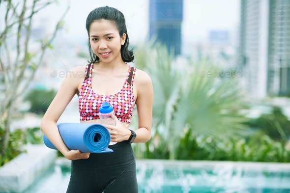 Asian sports coach outdoors - Stock Photo - Images