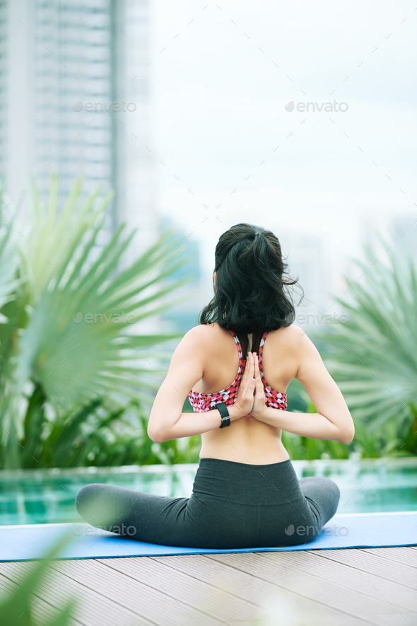 Woman doing yoga outdoors - Stock Photo - Images
