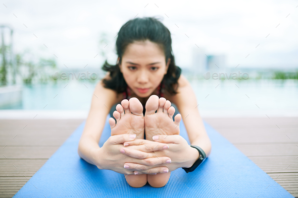 Flexible woman exercising outdoors - Stock Photo - Images