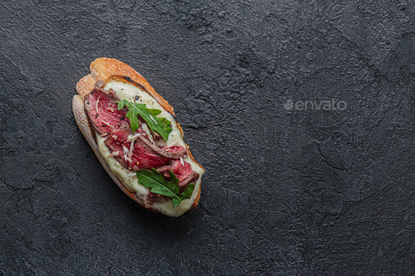 Close view of crostini with roast beef, copy space - Stock Photo - Images
