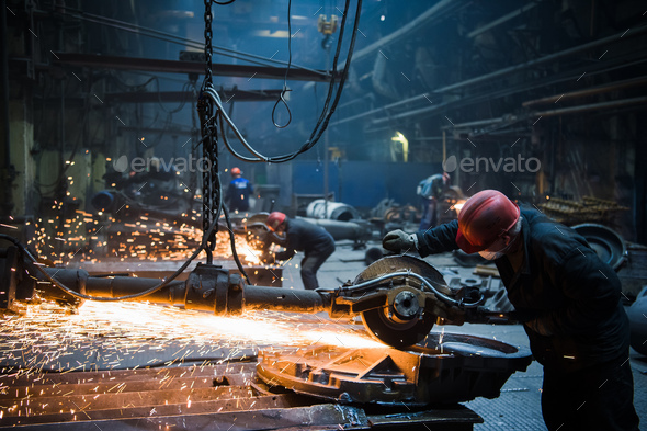 Welder used grinding stone on steel in factory with sparks - Stock Photo - Images