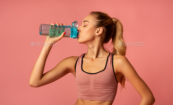 Fit Girl Drinking Water During Workout, Studio Shot - Stock Photo - Images
