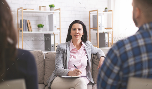 Confident psychologist working at marital therapy session - Stock Photo - Images