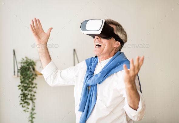 Augmented reality. Mature man with virtual headset - Stock Photo - Images