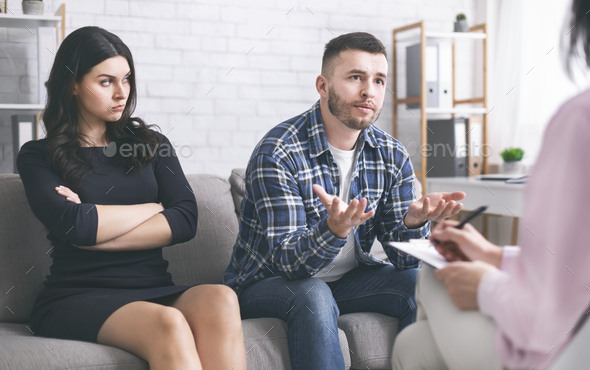 Young man talking to psychotherapist at marital consultation - Stock Photo - Images