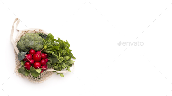Fresh vegetables and greens inside eco bag isolated on white - Stock Photo - Images
