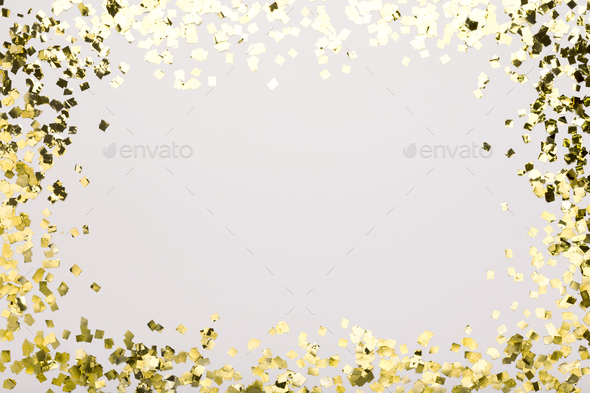 Golden confetti sparkling on white background with copy space - Stock Photo - Images