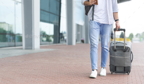 Man walking to airport with luggage, going on board - Stock Photo - Images
