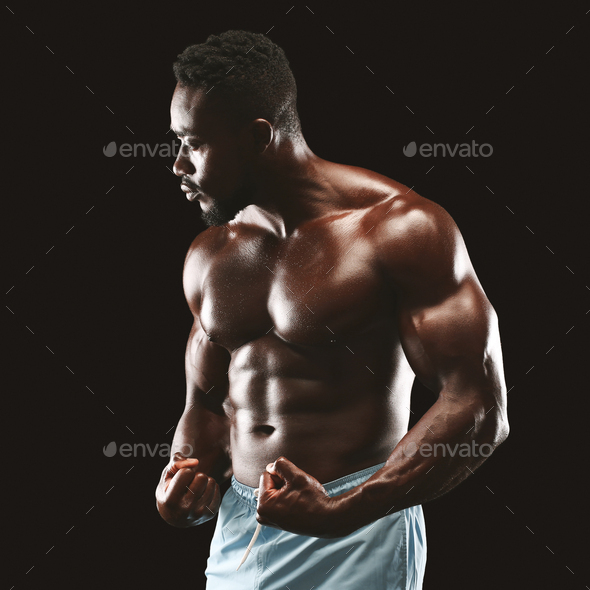Handsome african fittness model displaying his abdominals - Stock Photo - Images