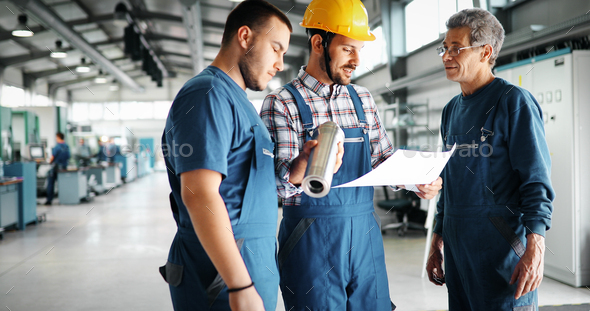 Team Of Engineers Having Discussion In Factory - Stock Photo - Images
