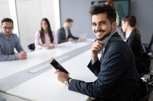 Portrait of handsome successful businessman holding tablet - Stock Photo - Images