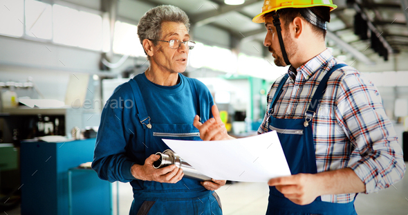 Engineer Teaching Apprentices To Use Computerized cnc metal processing machines - Stock Photo - Images