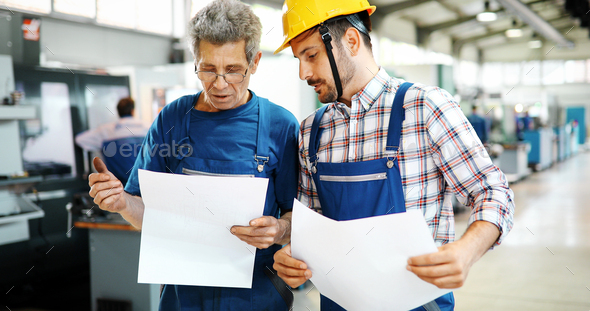 Supplier with engineer checking on production in factory - Stock Photo - Images