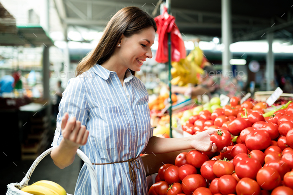 Beautiful happy young women shopping vegetables and fruits - Stock Photo - Images