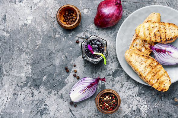 Onion jam in glass jar - Stock Photo - Images