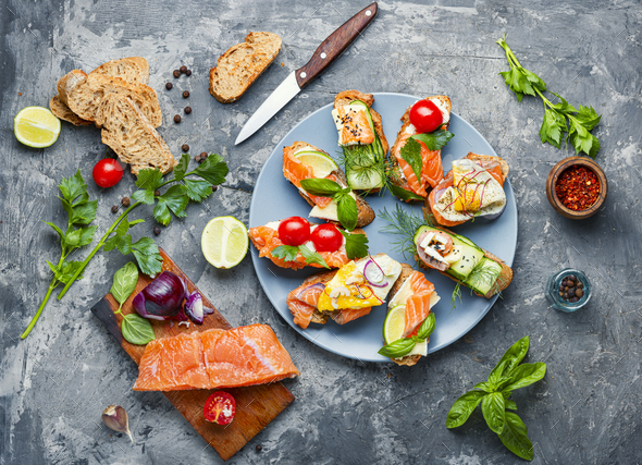 Assorted bruschetta with fish - Stock Photo - Images