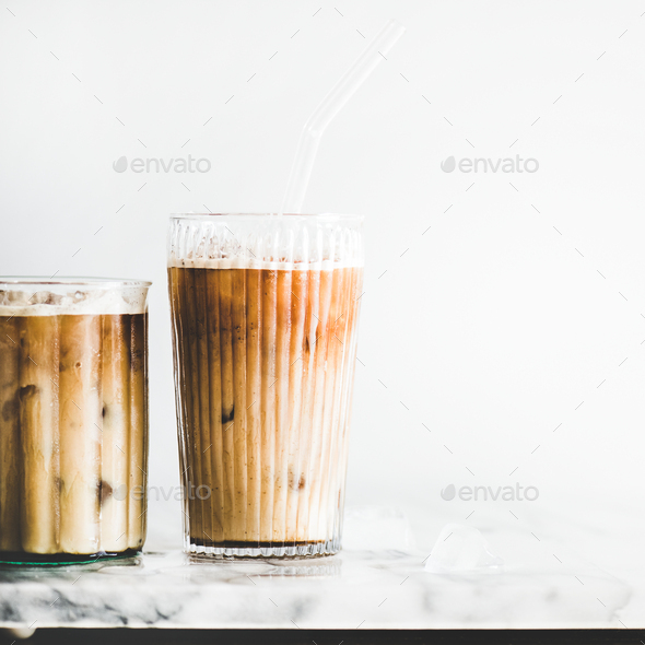 Iced latte coffee in glasses with straws, square crop - Stock Photo - Images
