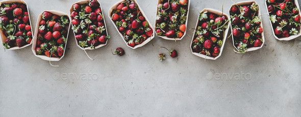 Fresh strawberries in plastic-free boxes over grey background, wide composition - Stock Photo - Images