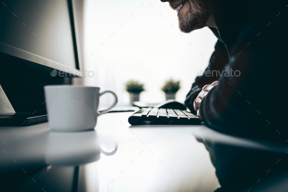 Computer hacker stealing information from web - Stock Photo - Images