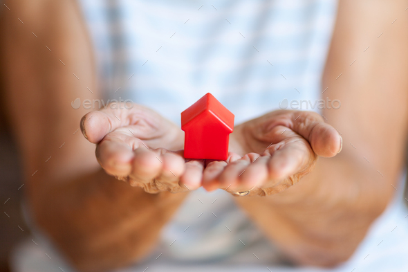 Elderly woman and her property - Stock Photo - Images