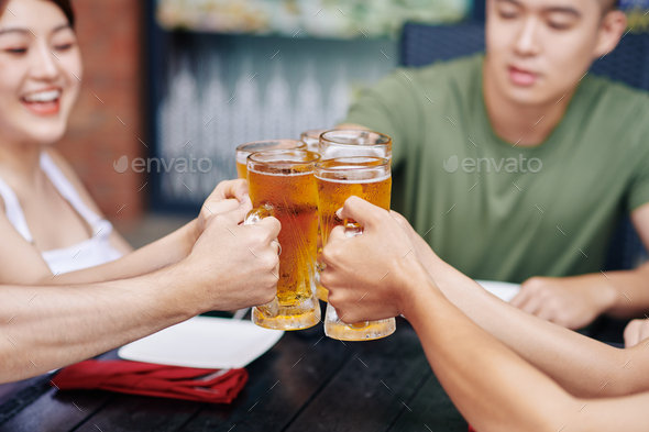 People toasting with beer - Stock Photo - Images