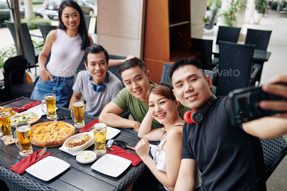 Selfie portrait of friends at restaurant - Stock Photo - Images