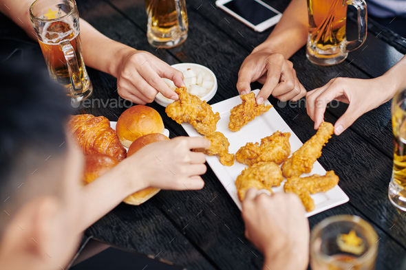 People eating fried chicken - Stock Photo - Images