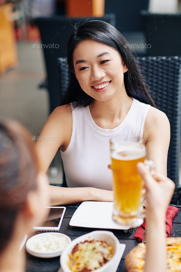 Happy woman resting at the restaurant - Stock Photo - Images