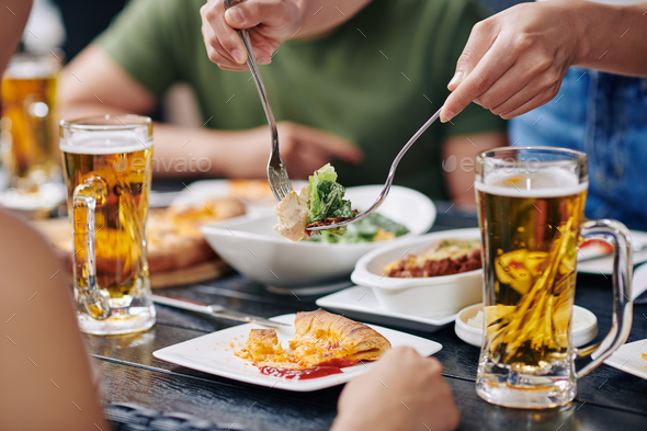 People eating food at the table - Stock Photo - Images