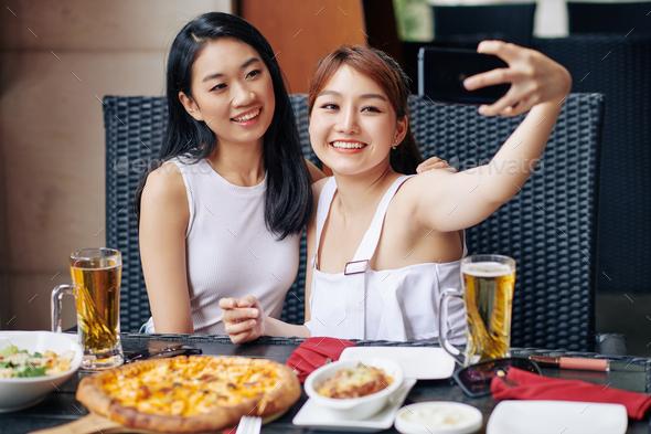 Selfie portrait with friend - Stock Photo - Images
