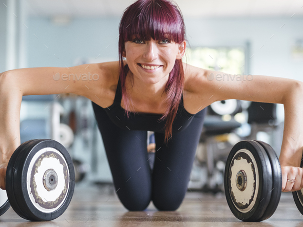 attractive young female exercising in a gym - Stock Photo - Images