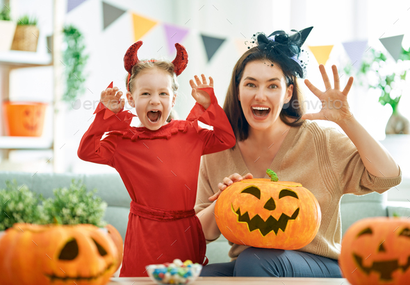 family celebrating Halloween - Stock Photo - Images