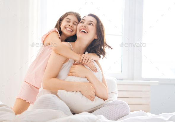 girl and her mother enjoying sunny morning - Stock Photo - Images