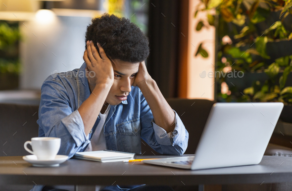 Desperate freelancer having troubles with his ptoject - Stock Photo - Images