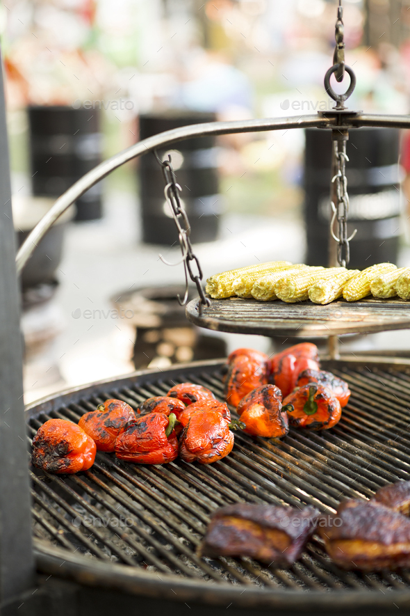 Grilled assorty of fresh and juicy vegetables and meat on grid - Stock Photo - Images