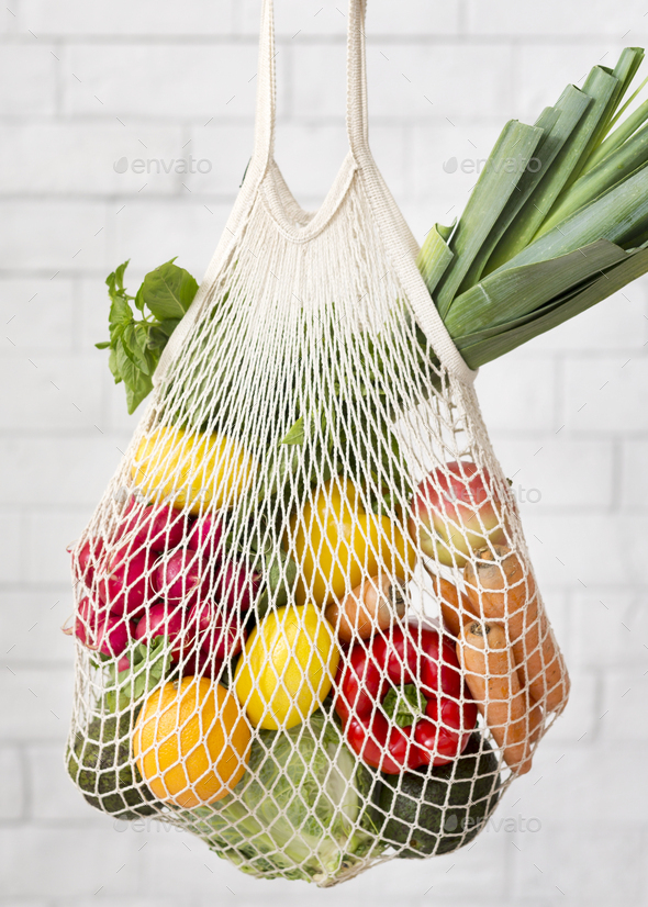 Plastic free eco bag with colorful fresh and organic vegetables - Stock Photo - Images