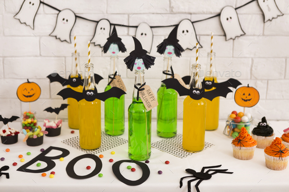 Halloween party in office with fresh toxic cocktails and decorations - Stock Photo - Images