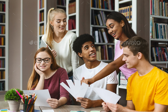 Young graphic designers choosing colors for new project - Stock Photo - Images