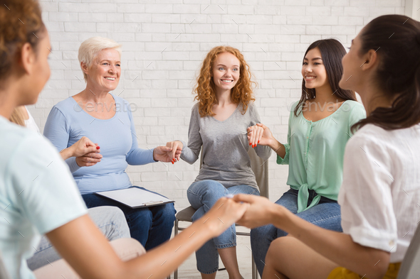 Smiling Diverse Women Sitting In Circle During Group Therapy Indoor - Stock Photo - Images
