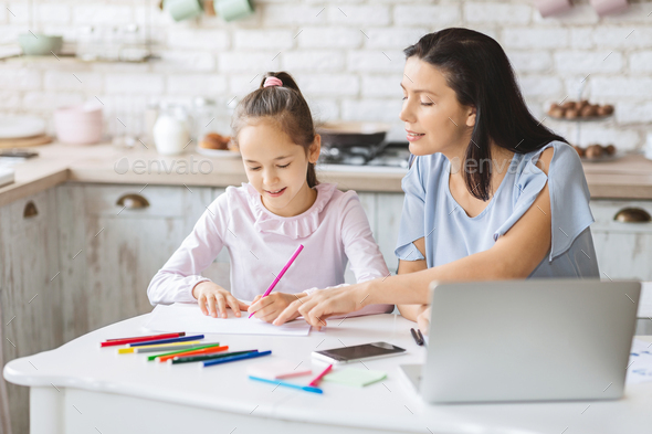 Little girl having lessons with tutor at home - Stock Photo - Images
