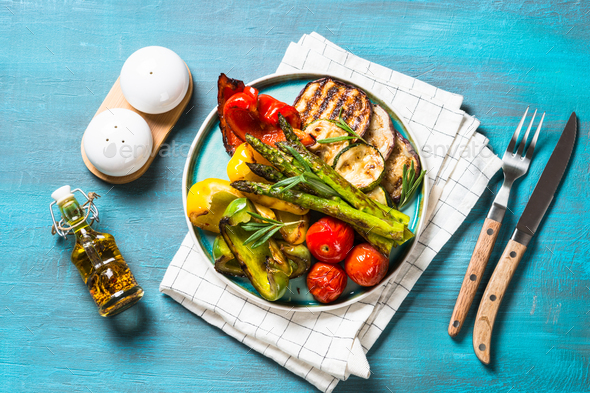Grilled vegetables - zucchini, paprika, eggplant, asparagus and tomatoes - Stock Photo - Images