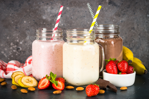 Banana, chocolate and strawberry milkshakes - Stock Photo - Images